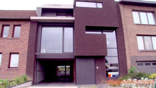 Une maison de(s)rangée